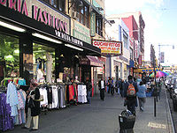 """Storefronts at Lexington Avenue and 116th Street at East Harlem, Manhattan, also known as Spanish Harlem or """"El Barrio"""""""