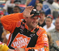 Tony Stewart (seen here in 2007) had an impressive rookie season, winning three races along with the Rookie of the Year award, and finished fourth in the final point standings.