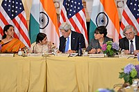 U.S. Secretary of State John Kerry chats with Indian External Affairs Minister Sushma Swaraj during the U.S.-India Joint Strategic and Commercial Dialogue Opening Plenary, Washington, D.C., on September 22, 2015.