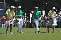 Simpson (second from left) and Bubba Watson (third from left) at the 2011 Presidents Cup
