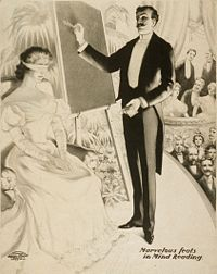 A mentalist on stage in a mind-reading performance, 1900