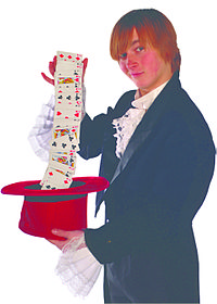 A stage magician using a top hat as a prop