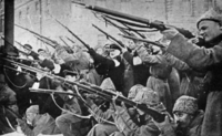 Revolutionaries attacking the tsarist police in the early days of the February Revolution.