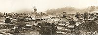 Part of a panoramic view of Kuala Lumpur c.1884. To the left is the Padang. The buildings were constructed of wood and atap before regulations were enacted by Swettenham in 1884 requiring buildings to use bricks and tiles. The appearance of Kuala Lumpur transformed rapidly and greatly in the following years.