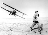 Grant in the crop duster chase in North by Northwest (1959)