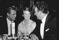 Grant with Betsy Drake and saxophonist Dick Stabile (right) in 1955