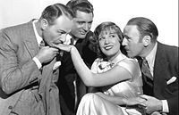 With Roland Young (right), Lili Damita (center), and Charlie Ruggles (far left) in his debut film This is the Night (1932)