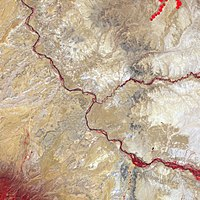 False-color satellite image of the Four Corners. Bright red lines are vegetation along the major rivers of the area.