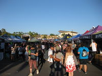 Artist, record label, and sponsor tents occupy the central area of the tour stops, selling merchandise and holding autograph signings.
