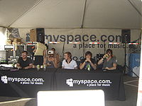 Anberlin preparing for a meet-and-greet at the MySpace tent on the 2007 tour. Performers often meet with fans and sign autographs at the various artist and sponsor tents.