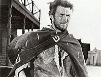 """Clint Eastwood as the ambiguously-named protagonist of the Dollars Trilogy (marketed as """"the Man with No Name"""") in a publicity image of A Fistful of Dollars, a film by Sergio Leone"""