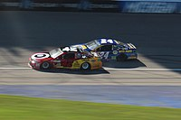 Kyle Larson and Chase Elliott battle for the lead in the later stages of the race