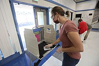 A poll worker sanitizes an election booth in Davis, California