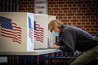 Voters cast ballots at Roosevelt High School in Des Moines, Iowa