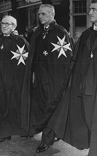 Fairbanks in 1958 wearing the mantle and insignia of a Knight of Justice of the Order of St. John.