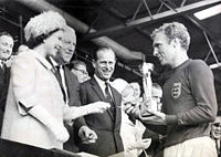The Queen presents the Jules Rimet Trophy to England's team captain Bobby Moore after the 1966 World Cup Final.