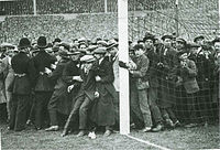 Crowds at the edges of the pitch