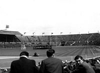 A marching band entertains the incoming crowd prior to the 1956 Rugby League Cup Final