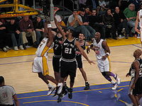 Duncan (#21) attempts to block Kobe Bryant's shot in a game against the Los Angeles Lakers at the Staples Center.