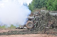 Firing of a L118 light gun 105 mm howitzer of the Portuguese Army