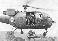 Portuguese paratroopers jump from an Alouette III helicopter in an air-mobile assault in Angola, in the early stages of the Overseas Wars