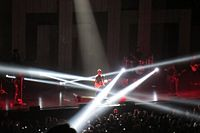 Bruno Mars and The Hooligans performing with strobe lights