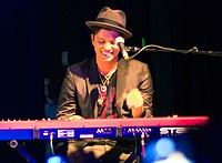 Bruno Mars playing the keyboard in a concert in Houston, Texas in 2010