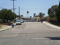 PSA 182 crash site as it appeared in 2010: Looking west down Dwight St., Nile Street intersection is in foreground; Boundary St. intersection in background. The initial impact was about 30 ft to the right of the photographer, on Nile St.