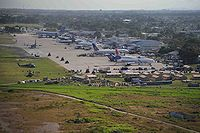 Planes loaded with aid supplies crowd the tarmac at Port-au-Prince airport, waiting to be unloaded, 18 January
