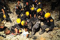 A woman is rescued alive from rubble several days after the initial quake