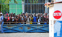 Haitians await the opening of a supply depot, 16 January