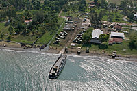 Landing ships move supplies onshore from the rescue fleet