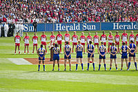The West Coast Eagles and Sydney Swans line up for the national anthem at the 2005 AFL Grand Final. Traditionally held at the MCG, the Grand Final is the highest attended club championship event in the world.