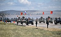 Mongolian, Chinese and Russian national flags set on armored vehicles during the large-scale military exercise Vostok 2018 in Eastern Siberia