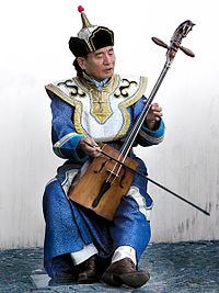 Musician playing the traditional Mongolian musical instrument morin khuur
