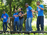 """The Bronx's P.L.A.Y.E.R.S. Club Steppers performing at the 2007 Fort Greene Park Summer Literary Festival in Brooklyn. (Note the T-shirts' inscription """"I ♥ BX"""" [Bronx], echoing the ubiquitous slogan """"I ♥ NY"""" [I Love New York] )."""