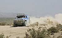 Rod Hall in a Hummer H3 during a Best in the Desert race