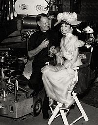 Hepburn with cinematographer Harry Stradling on the set of My Fair Lady