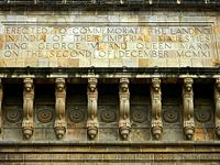 """Inscription on the gateway reading: """"Erected to commemorate the landing in India of their Imperial Majesties King George V and Queen Mary on the Second of December MCMXI"""""""