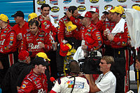 Dale Earnhardt Jr. (bottom), and team in victory lane in 2004