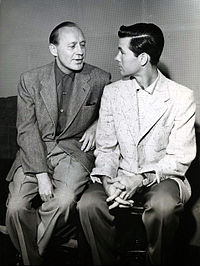 Carson as a guest on Jack Benny's television program, 1955