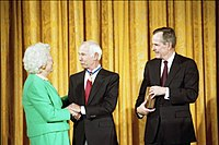 Carson being awarded the Presidential Medal of Freedom by President George H. W. Bush and First Lady Barbara Bush in 1992