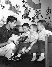 Carson reading a story to his three sons in 1955: From left: Chris, Cory, and Richard (Ricky)