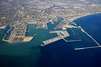Aerial view of the port and Valencia from the east