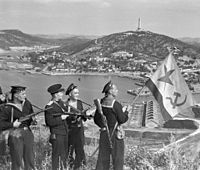 Pacific Fleet marines of the Soviet Navy hoist the Soviet naval ensign in Port Arthur, on 1 October 1945.