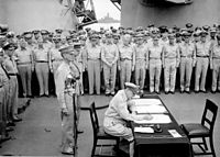 Douglas MacArthur signs the formal Japanese Instrument of Surrender on, 2 September 1945.