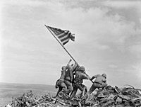 Raising the Flag on Iwo Jima, an iconic photograph taken by Joe Rosenthal on February 23, 1945, depicts six United States Marines raising a U.S. flag atop Mount Suribachi.
