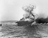The aircraft carrier explodes on 8 May 1942, several hours after being damaged by a Japanese carrier air attack.