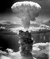 The mushroom cloud from the nuclear explosion over Nagasaki rising 60,000 feet (18 km) into the air on the morning of 9 August 1945