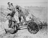 Marines fire captured mountain gun during the attack on Garapan, Saipan, 21 June 1944.